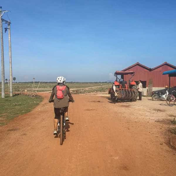 Gravel cycling in Cambodia on red gravel
