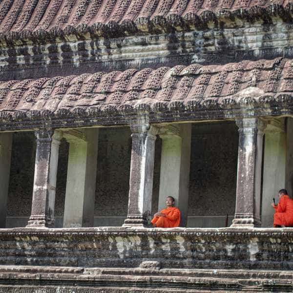 Monks at Angkor Was during a cycling tour