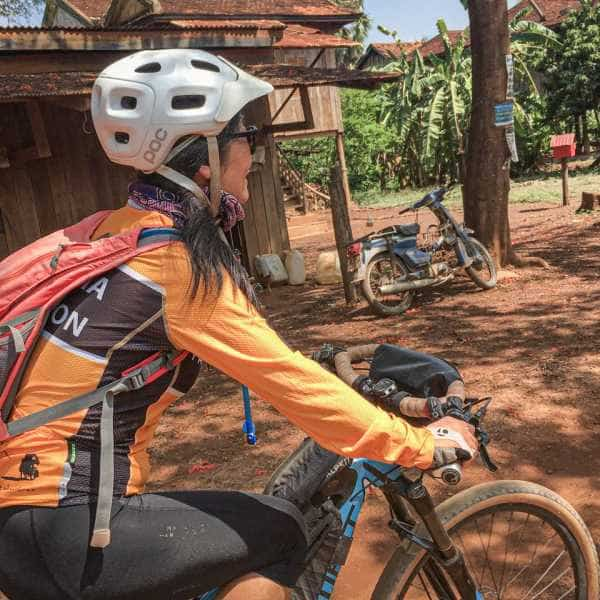 girl cycling on tour in Cambodia