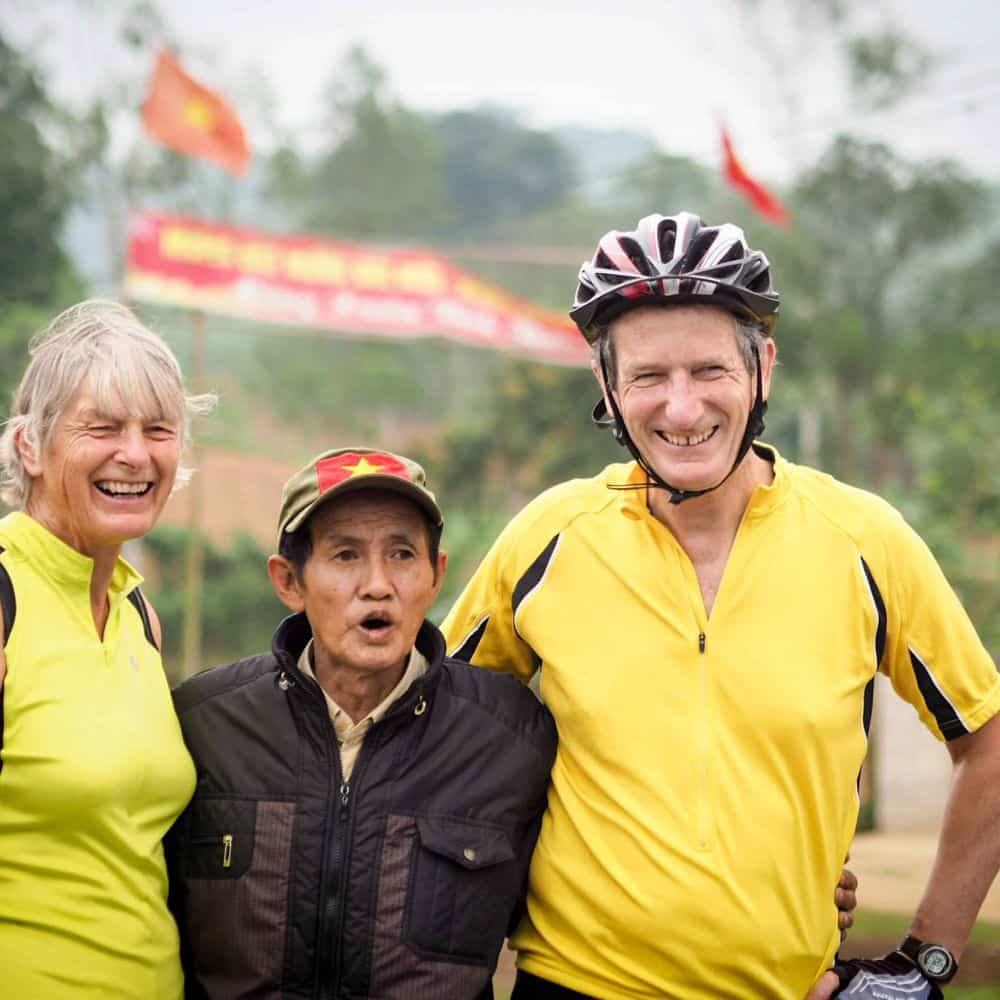 cyclists meeting a local man whilst touring Central Vietnam