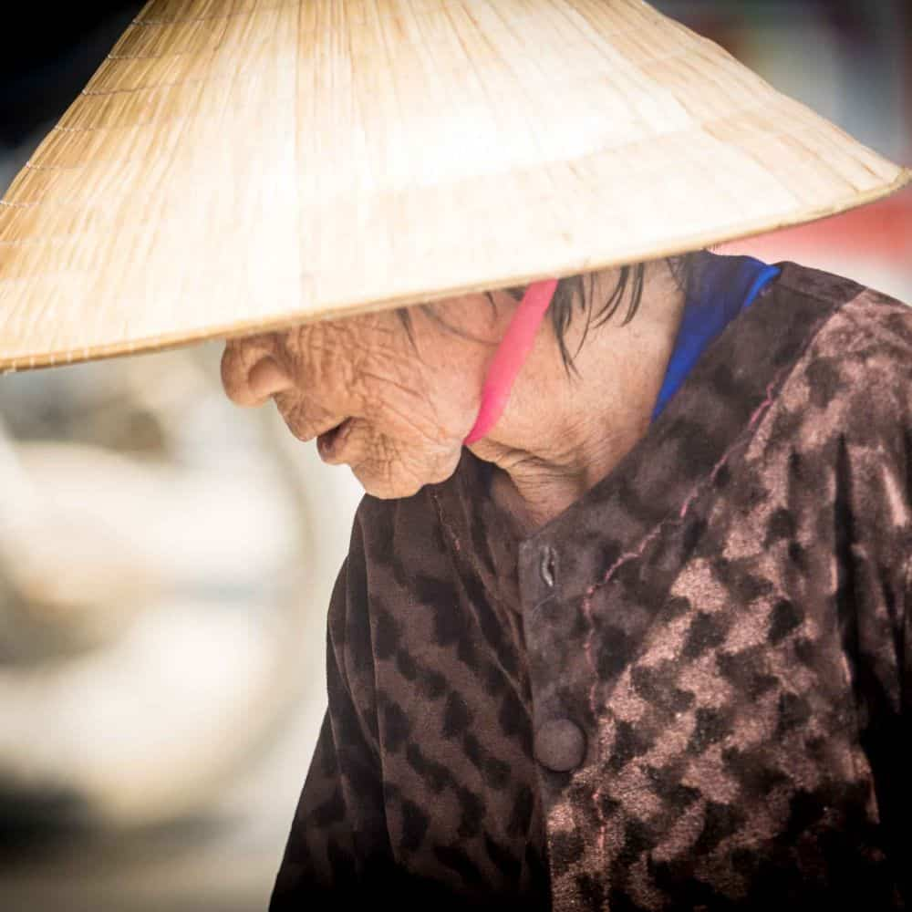 portrait of a Vietnamese lady in conical hat