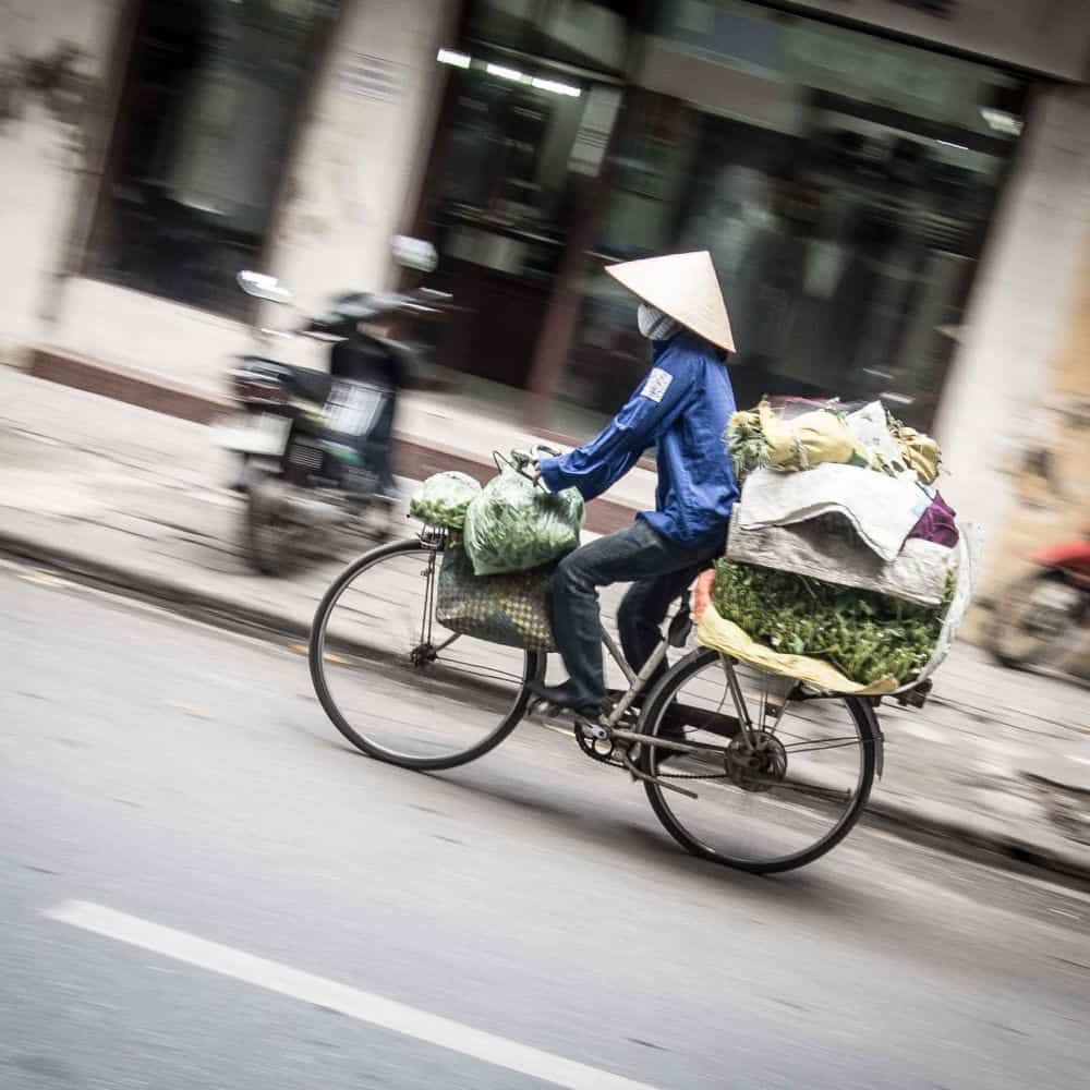 A street hawker on a bicycle in Hanoi