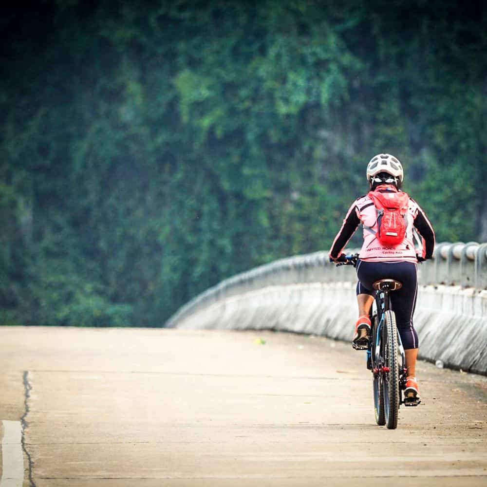 A lone lady cyclist on Vietnam's Ho Chi Minh Trail