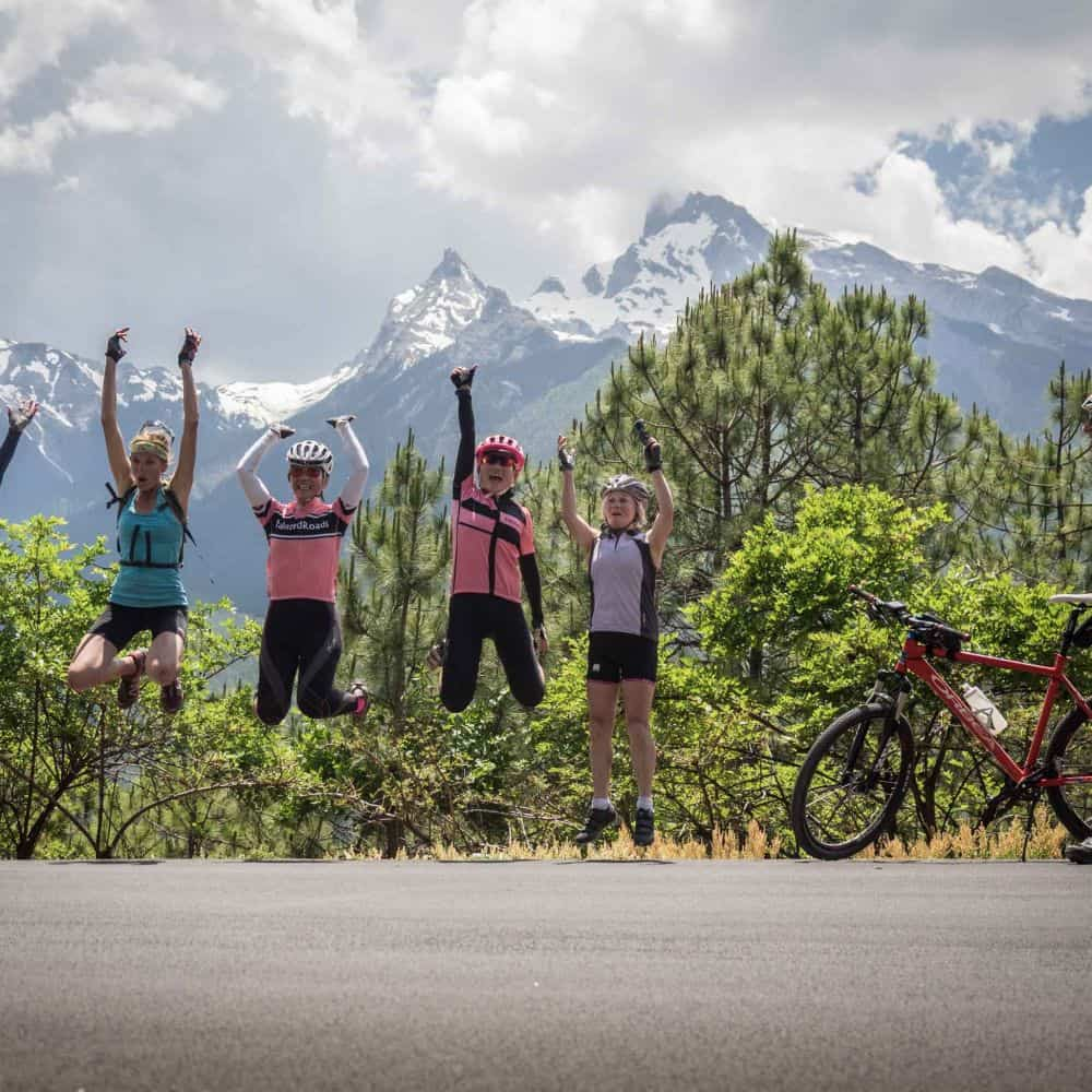 happy group of cyclists on holiday in Yunnan, China