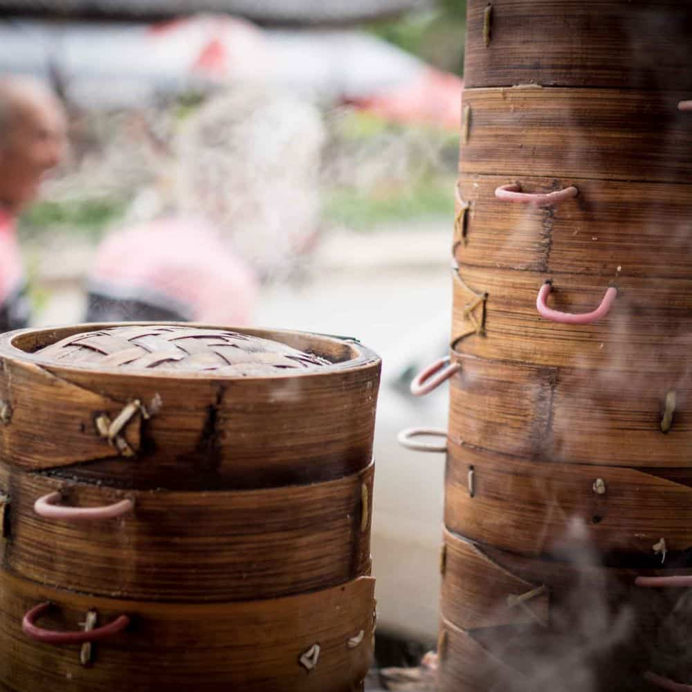 cyclist breakfast of steaming dumplins in Yunnan China
