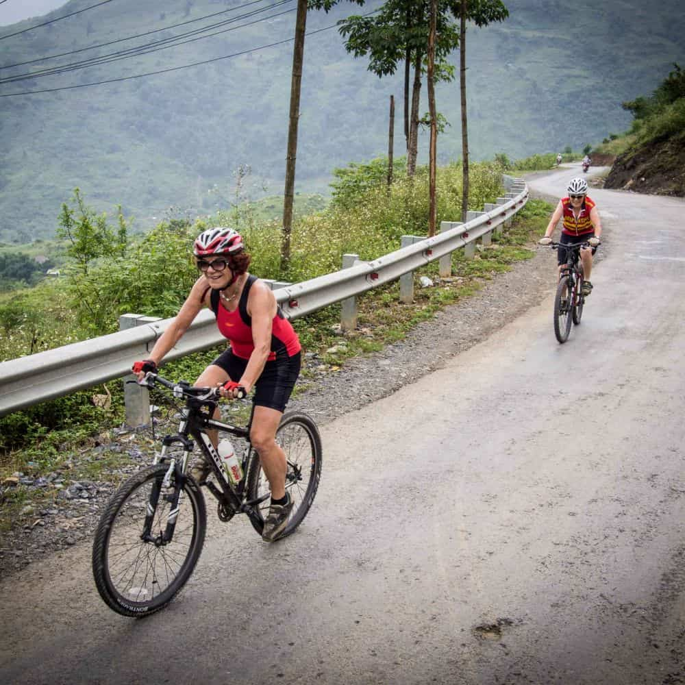 Two ladies cycling in the hills of Vietnam