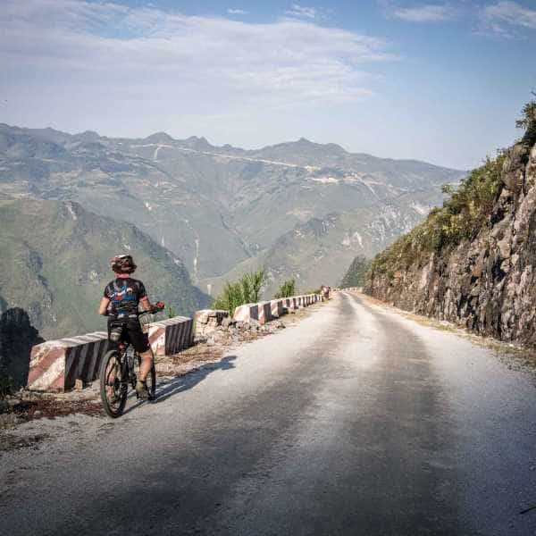Former Iron Man world champion Eddy Brockelsby enjoys the view of China on a cycling tour on Northeast Vietnam