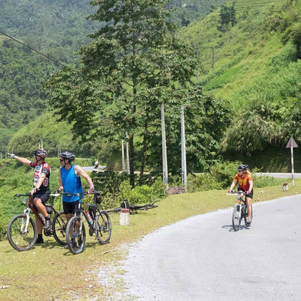 cyclists enjoying scenery on holiday in Vietnam