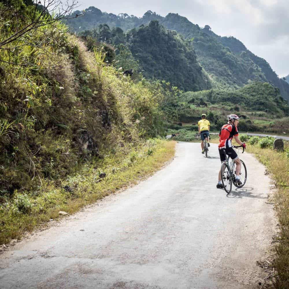 cyclists on the road in northeast Vietnam