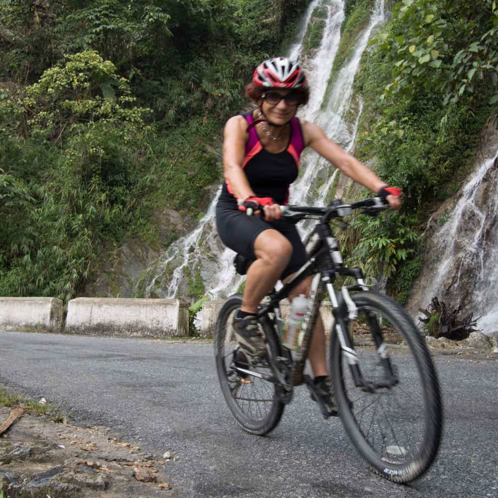 lady cyclist on holiday touring Vietnam