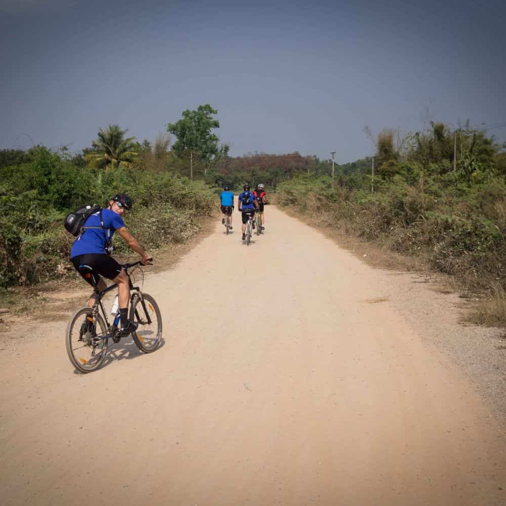 cyclists on a gravel road in northern Thailand