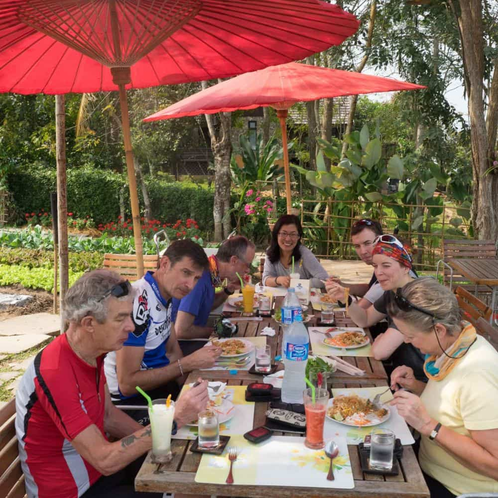 A bicycle tour group having lunch in north thailand