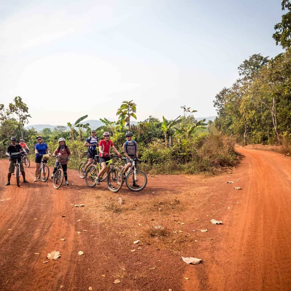 cyclists on a gravel road in north Thailand