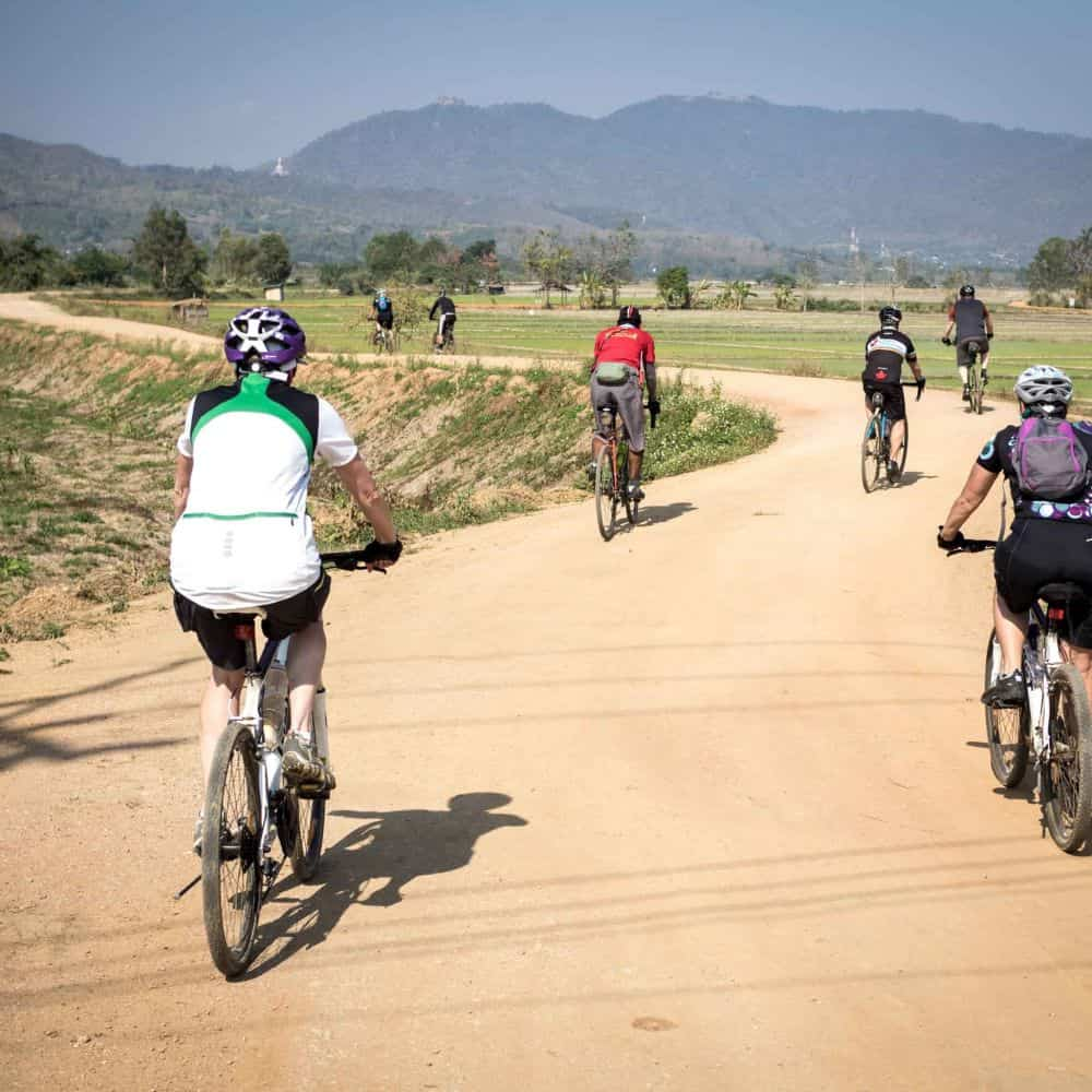 cycle tour group on gravel road in north Thailand