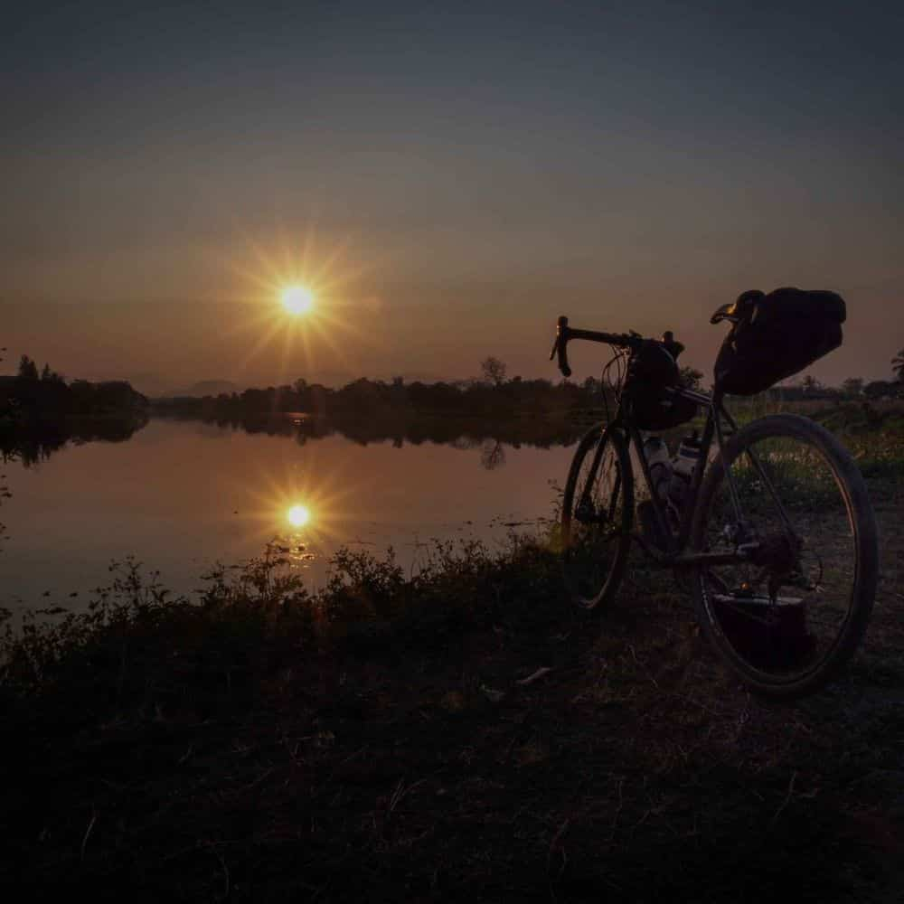 touring bicycle and sunset north Thailand