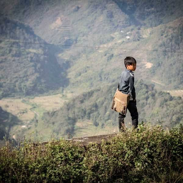 a young hill tribe lad overlooking a valley in northeast vietnam