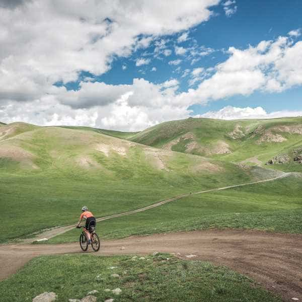 A cyclist on a Mongolian dirt road