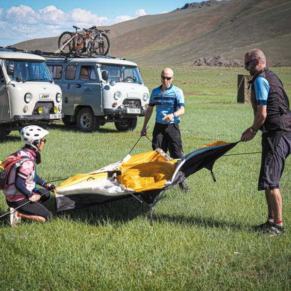 Cyclists camping in Mongolia's Altai Mountains