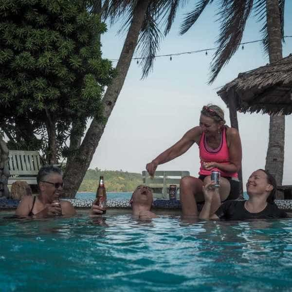 Bicycle tourists relaxing in a beach side pool at the end of a day cycling in south Thailand