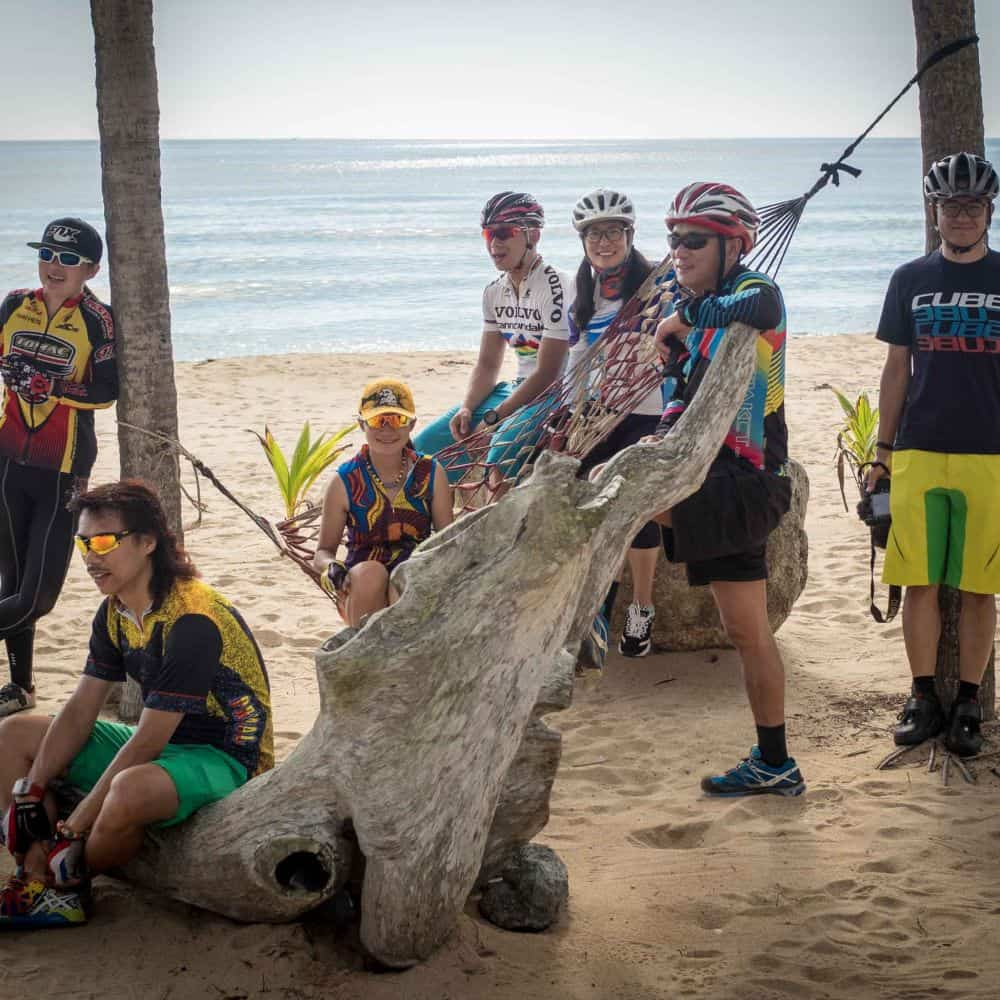 A group of cyclists on a beach in South Thailand
