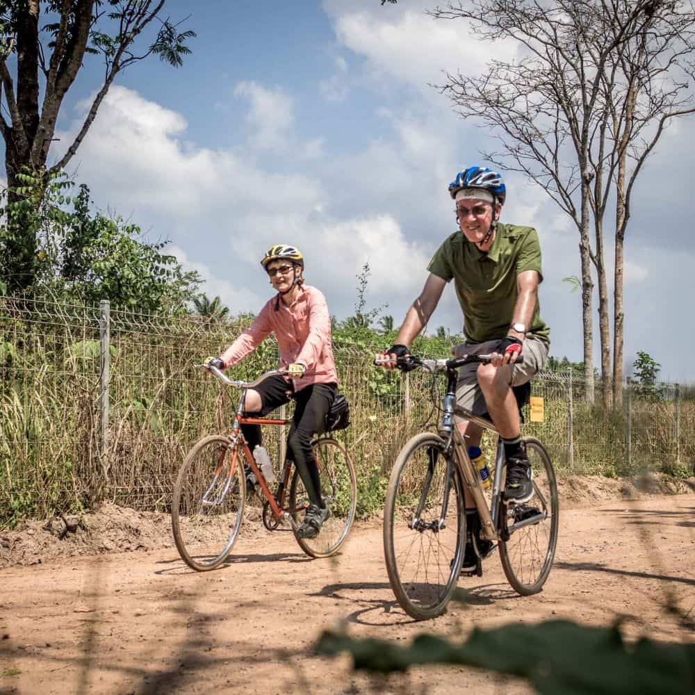A couple on a bicycle touring trip in Thailand