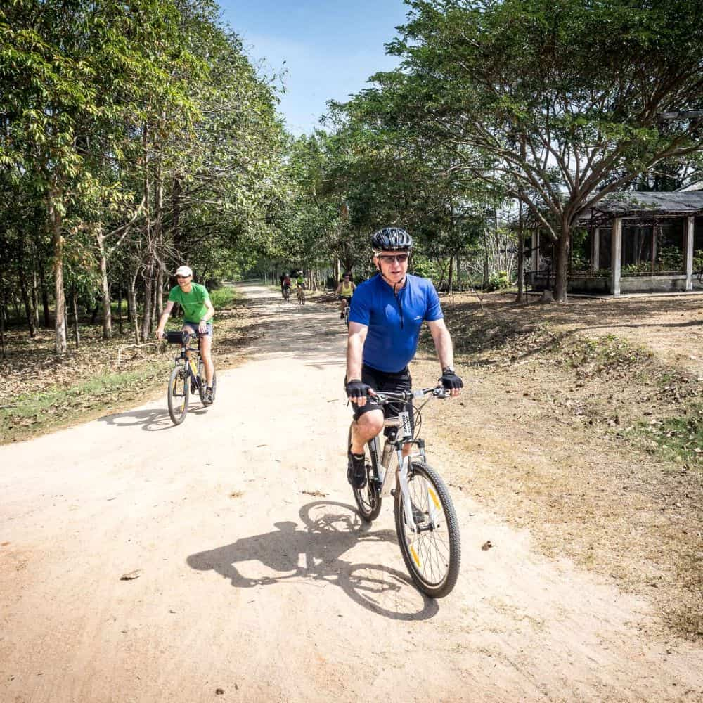 Cyclists on a gravel road in south Thailand
