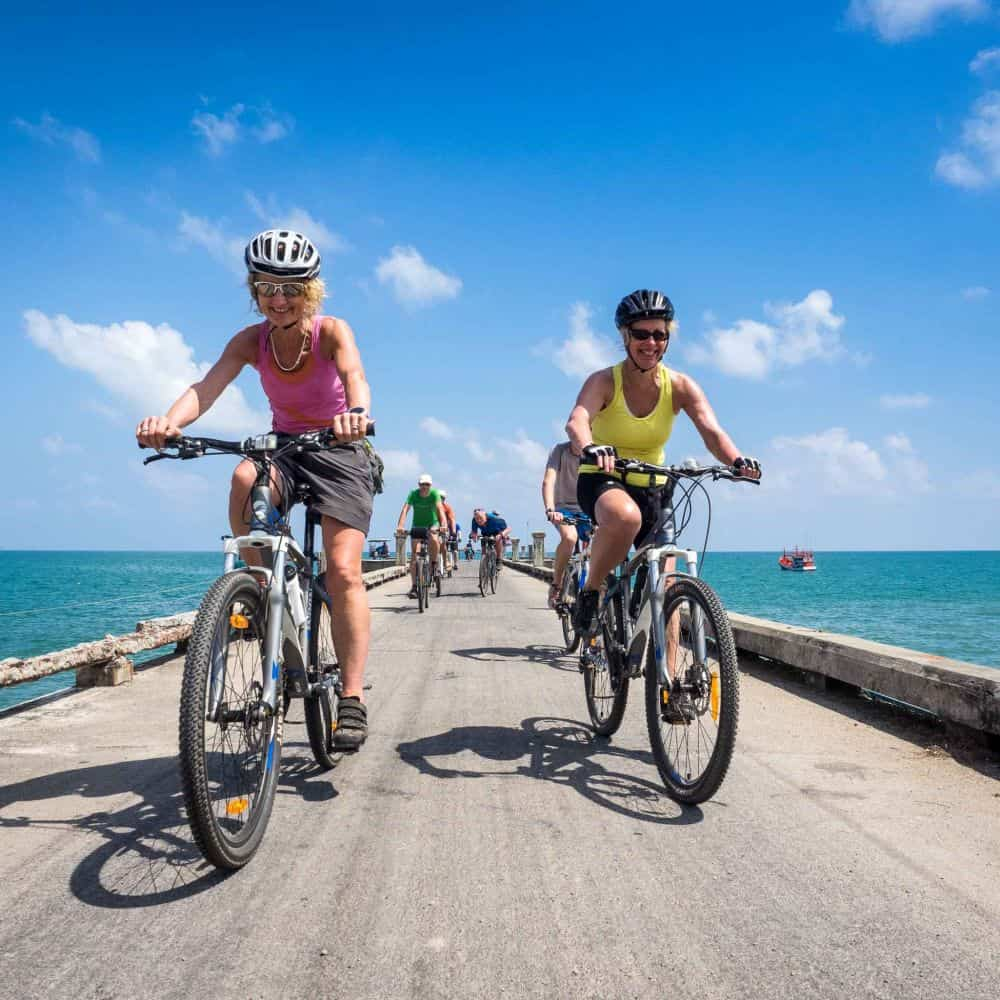 cyclist on a touring holiday in south Thailand ride along a jetty