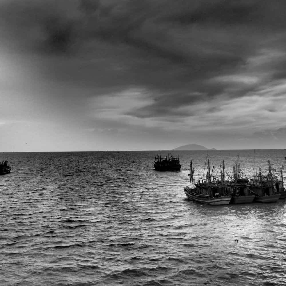 Atmospheric black and white boats at sea Vietnam