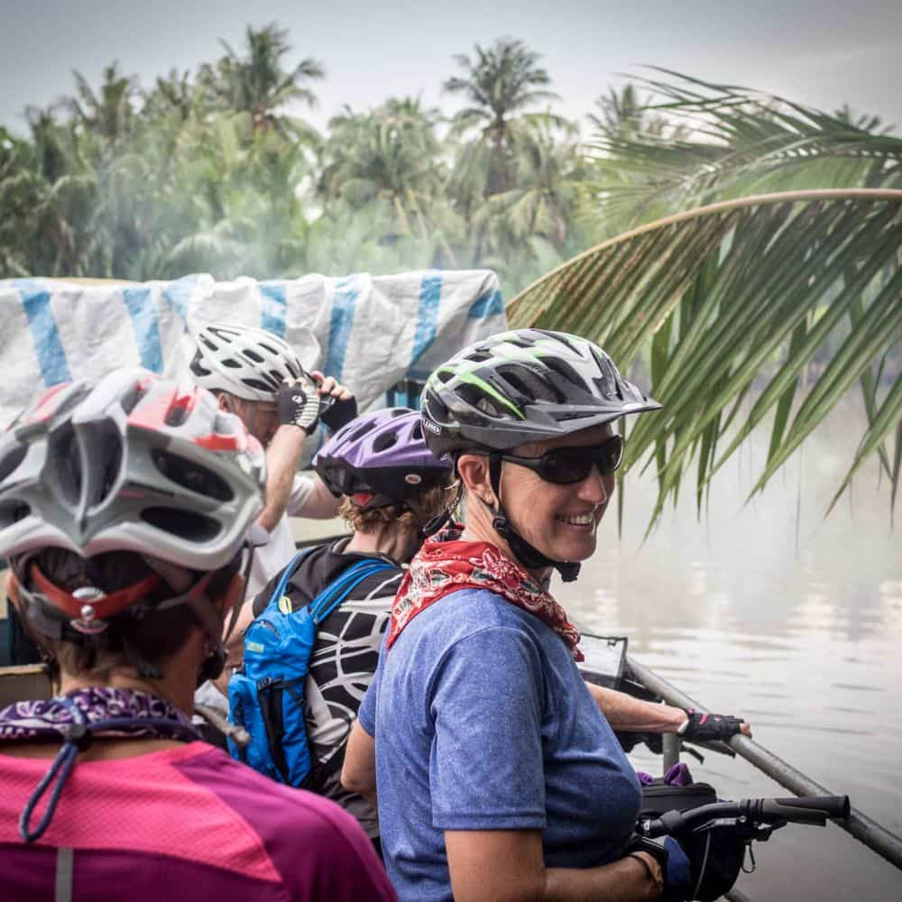 cyclists on a small ferry in South Vietnam