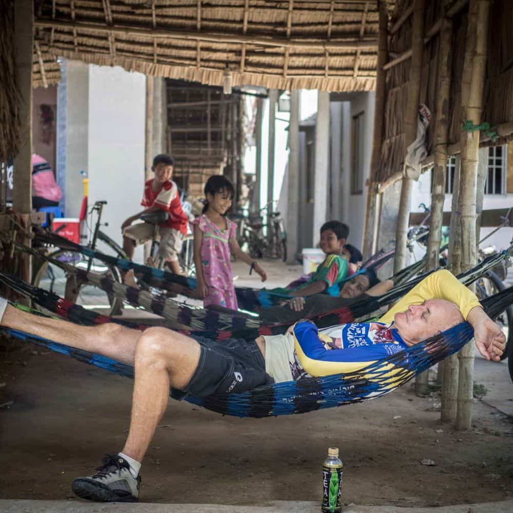 cyclist rests on a hammock in Vietnam