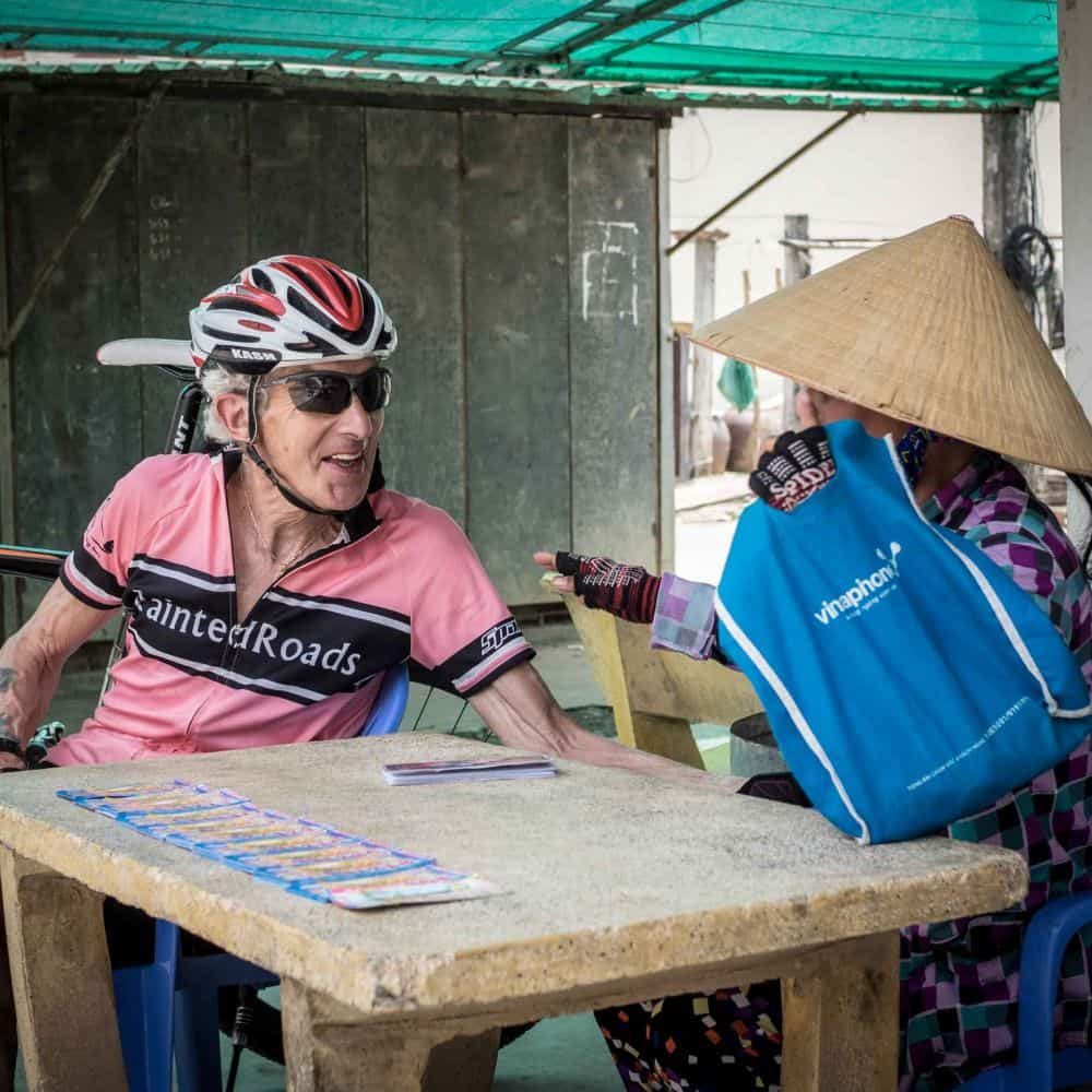 A cyclist meeting a local lady whilst touring South Vietnam