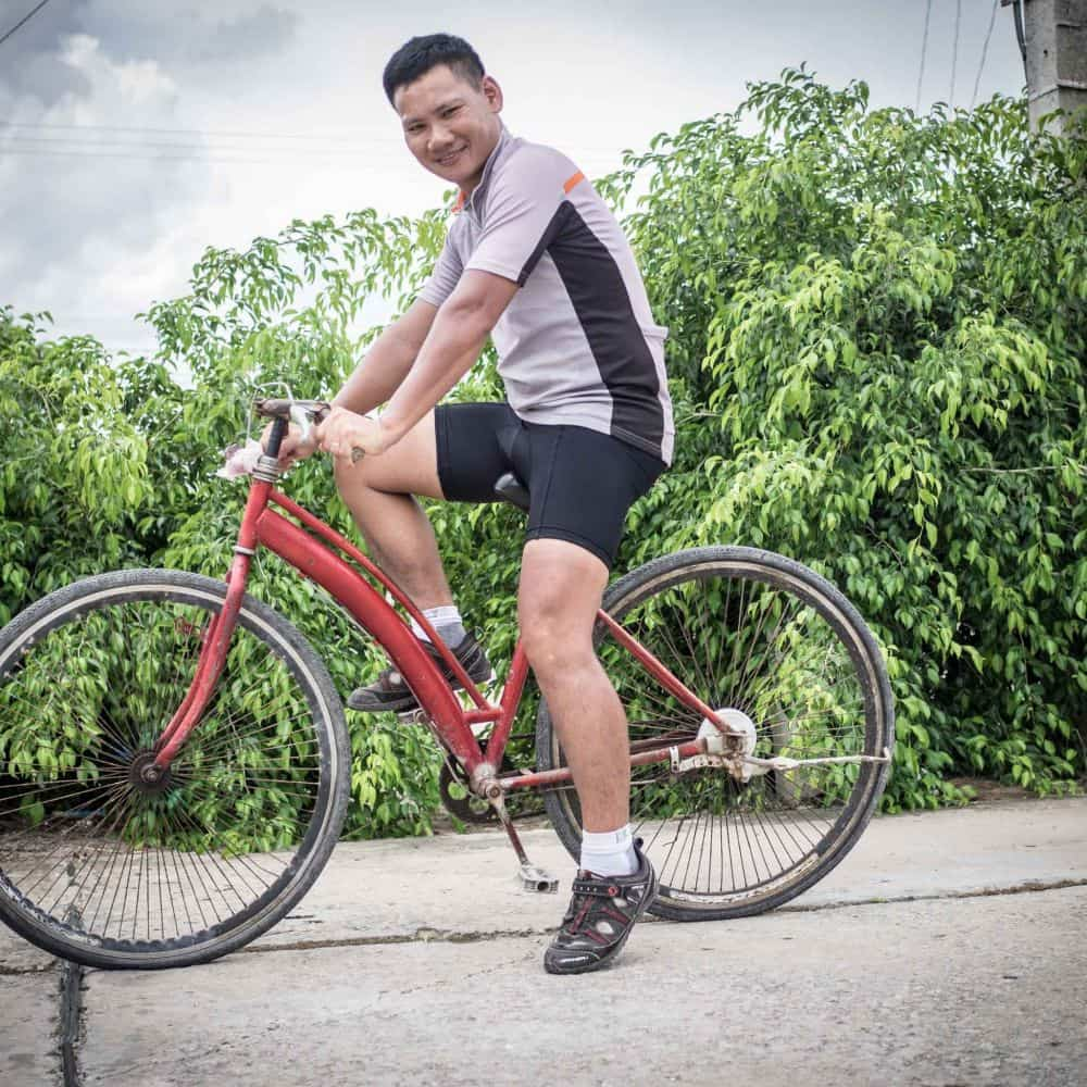 Vietnames man on a bicycle