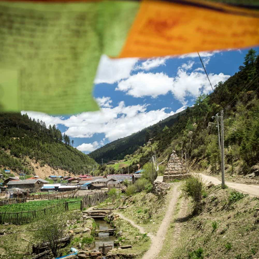 Tibetan prayer flags and gravel road in Sichuan China
