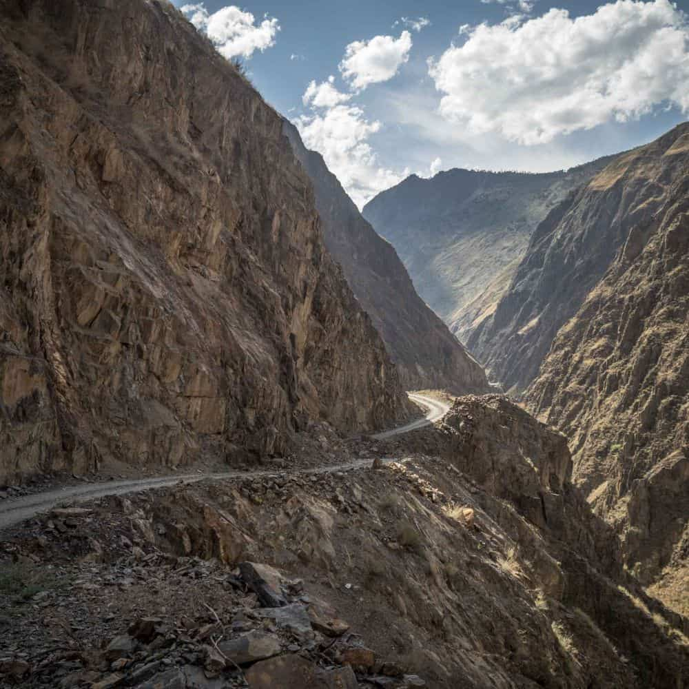 barren rocky valley on cycling tour eastern Tibet Sichuan China