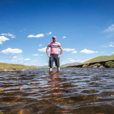 A cyclist in a Mongolian river
