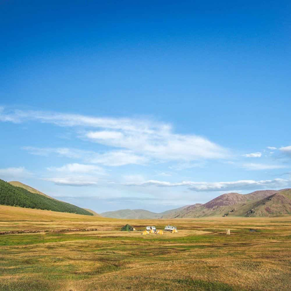 Blue sky and cyclists campsite in Mongolia