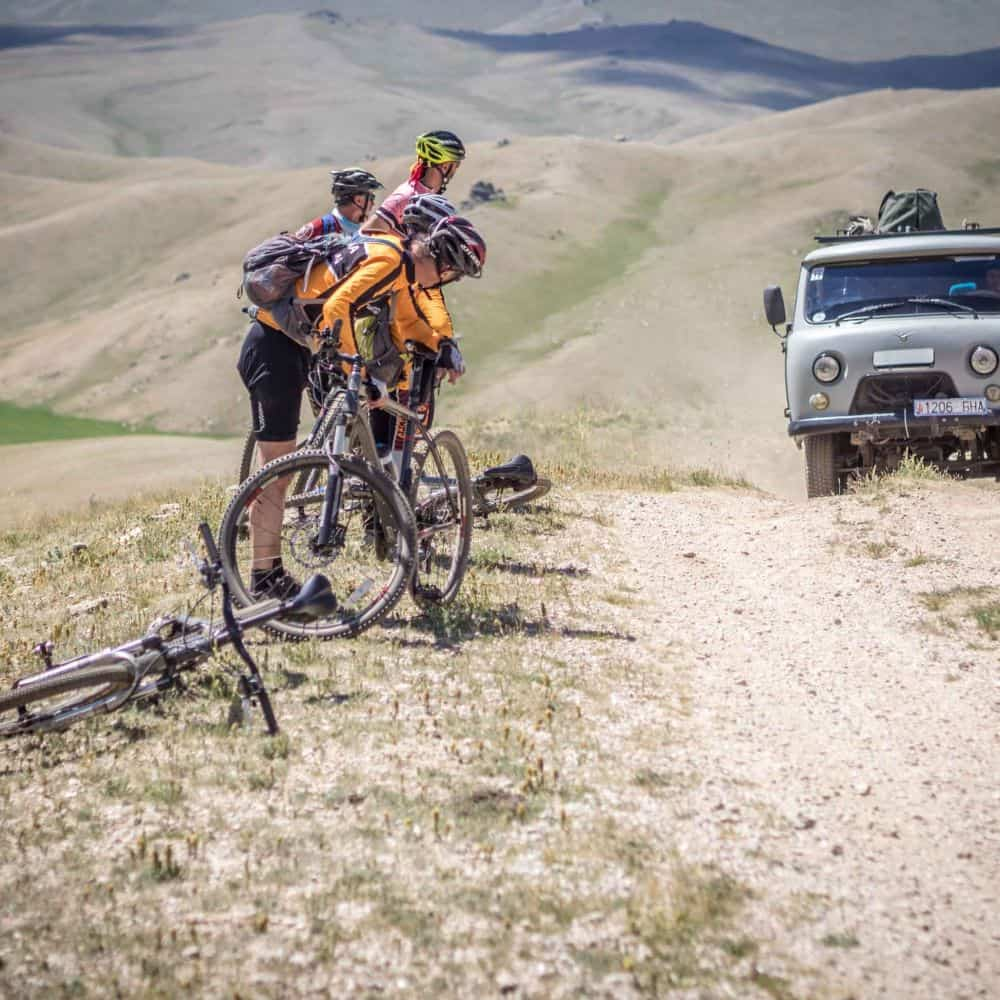 Cyclists and Russian truck in Mongolia