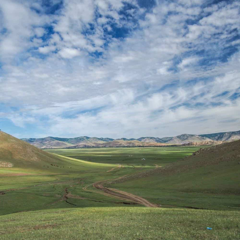 blue sky and pasture on a Mongolia cycling tour