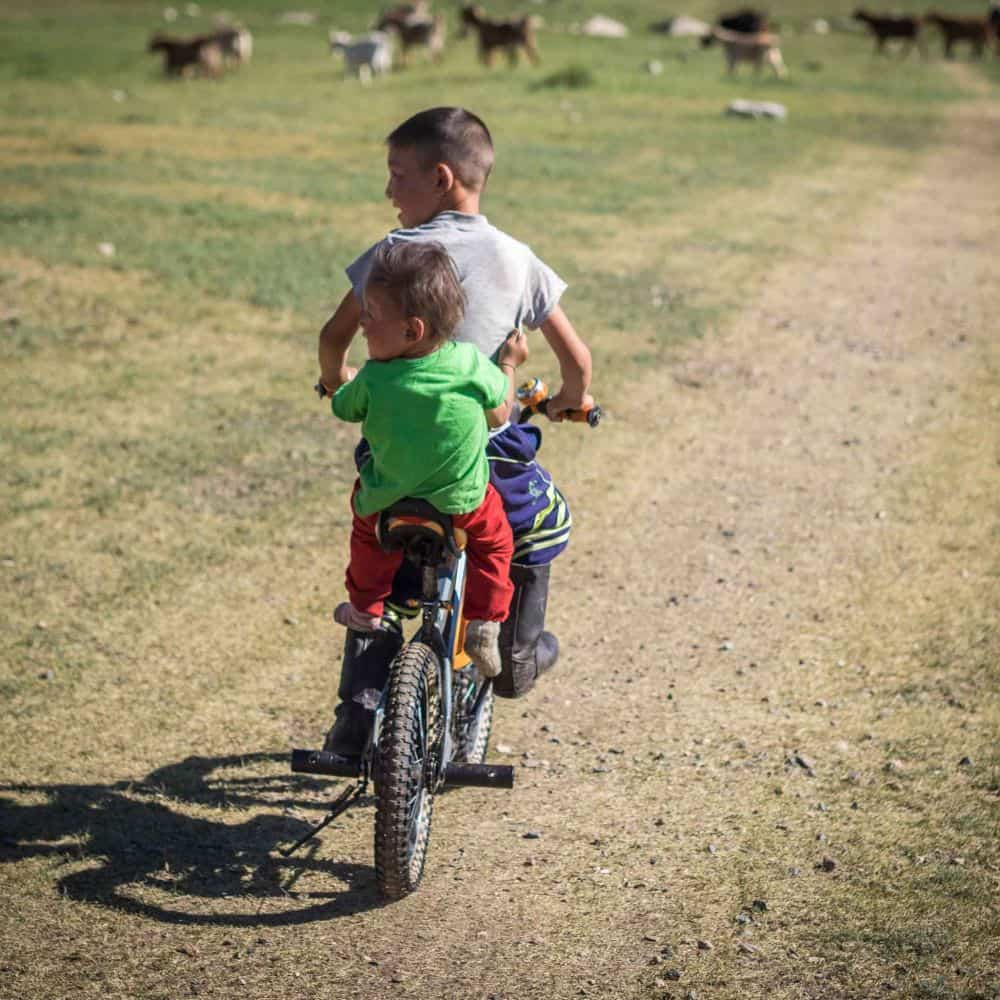 Mongolian children on a bicycle
