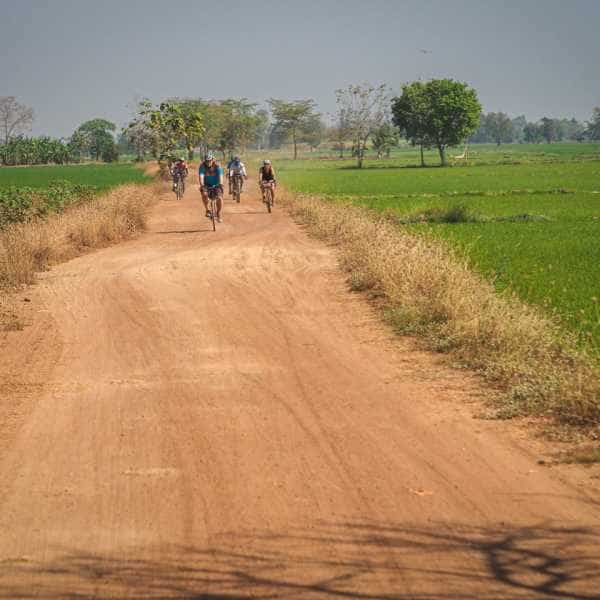 a group of gravel cyclist on gravel road in Thailand