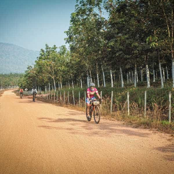 cycling a gravel road in Asia
