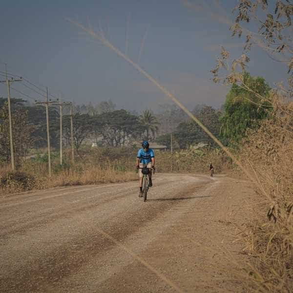 a gravel bike on a wide gravel road in Thailand