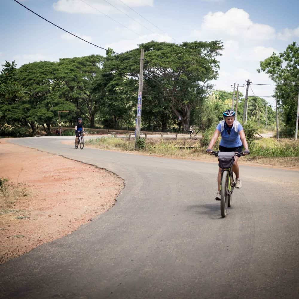 bicycle tour group on quiet road in Sri Lanka