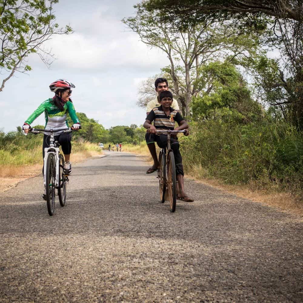 A touring cyclist meets local Sri Lankan boys on bicycle