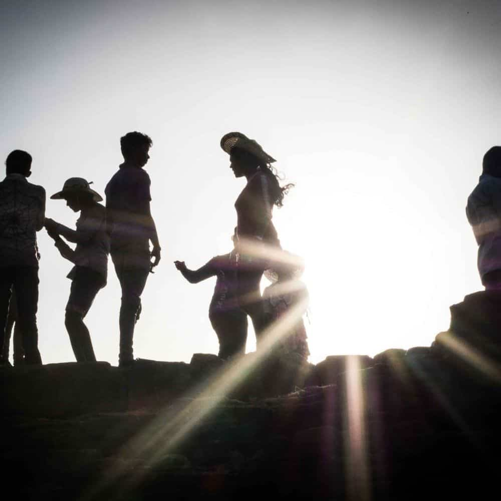 People and sunset on Galle fort wall in Sri Lanka