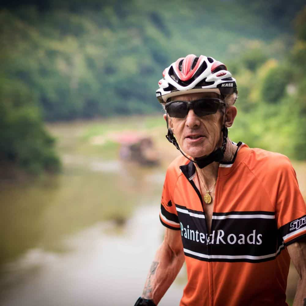 A veteran cyclist in on tour in Laos