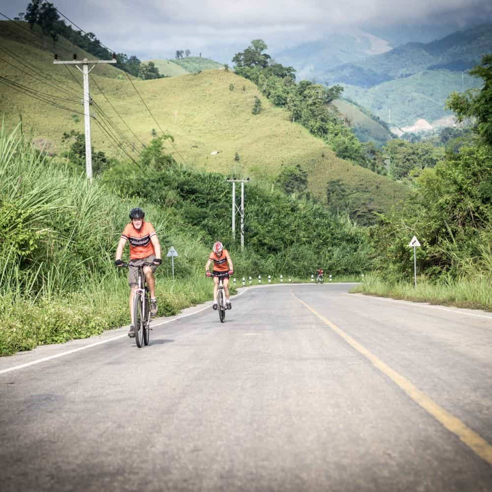 Cycling the final hill in Lao before Thailand