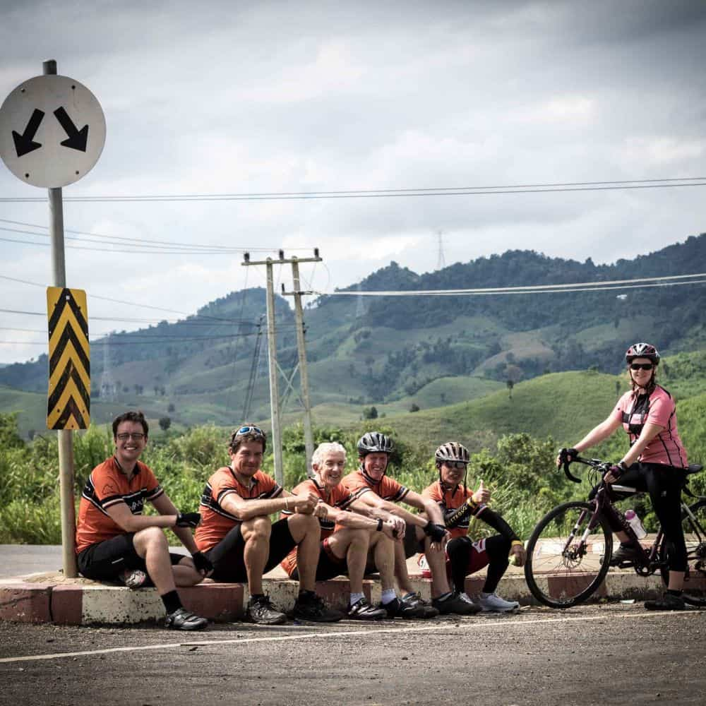 touring cyclists rest in Lao