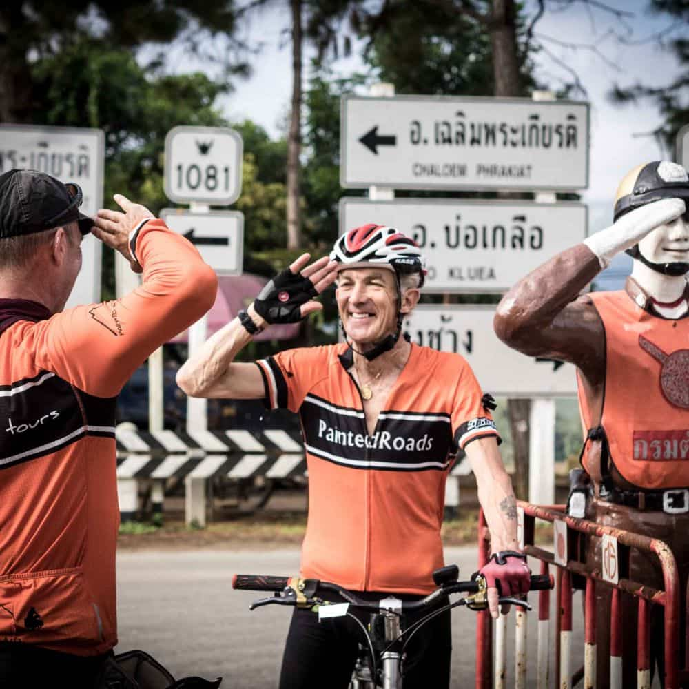Cyclists saluting in Thailand