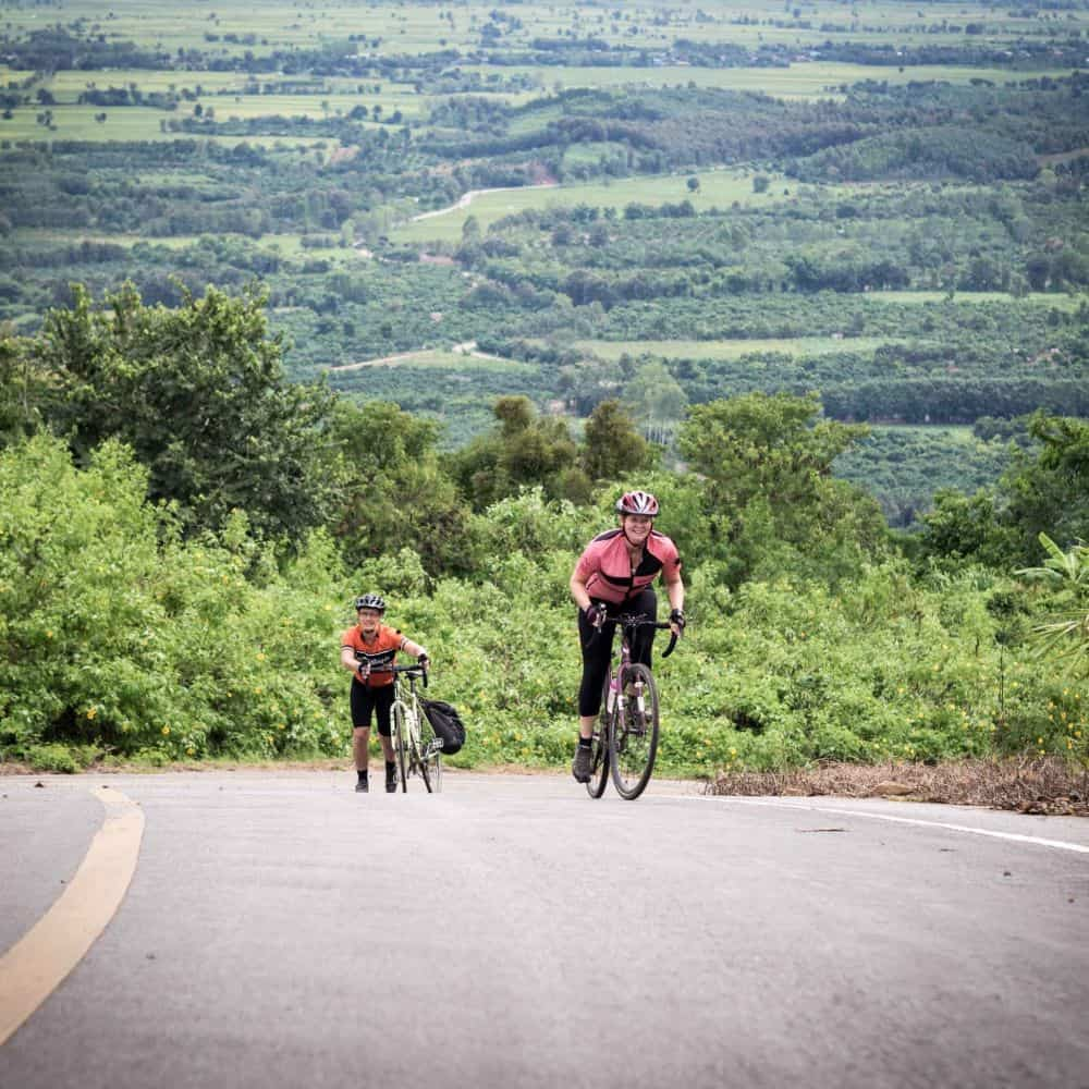 Cyclists on an 18% climb in Thailand